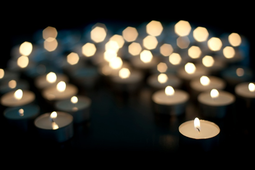 background image of out of focus christmas trealight candles with space of text